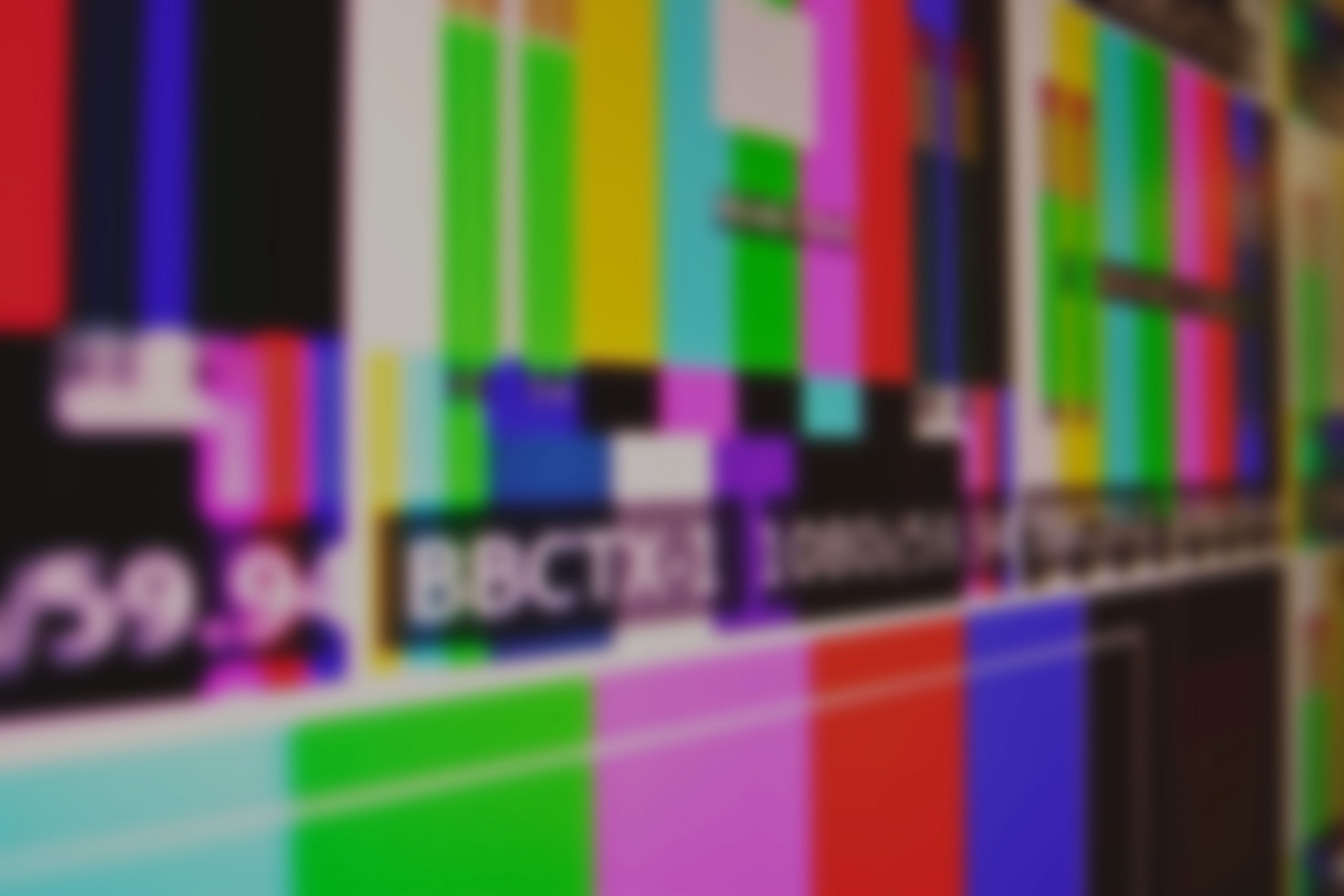 A photo of tv screens with colours and tv codes